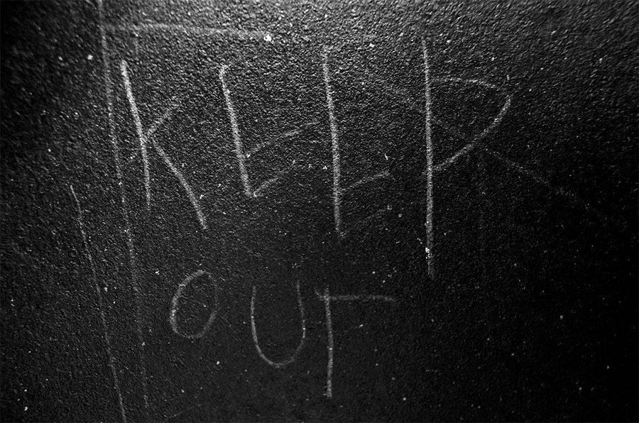 Sketched on the inside padded wall of a seclusion room at Northwest Junior HIgh reads the warning message,