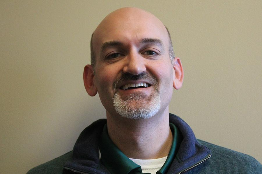 """Aside from counseling, Greg Yoder  occupies himself with other activities.  """"I actually am a camera operator for Iowa basketball games [...] we provide the in-house feed for the big screen so students may see me there."""" said Yoder"""