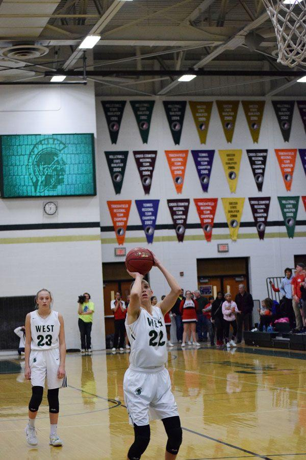 Logan Cook '18 makes her free throw during the game on Jan. 23, 2018.