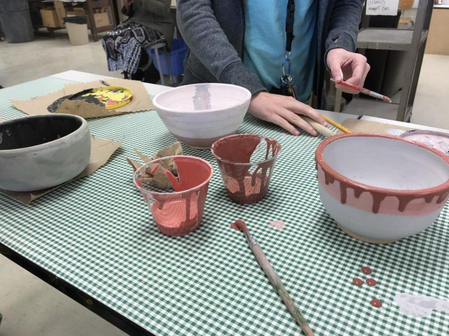In the 'Souper Bowl' event, students worked in Mr. Aanestad's class and made bowls for the University of Iowa's Rape Victim Advocacy Program's annual soup dinner.