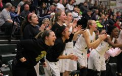 The team reacts in celebration after Lauren Zacharias '19 increased the lead for the Trojans to 49-34 on Friday, Jan. 19.