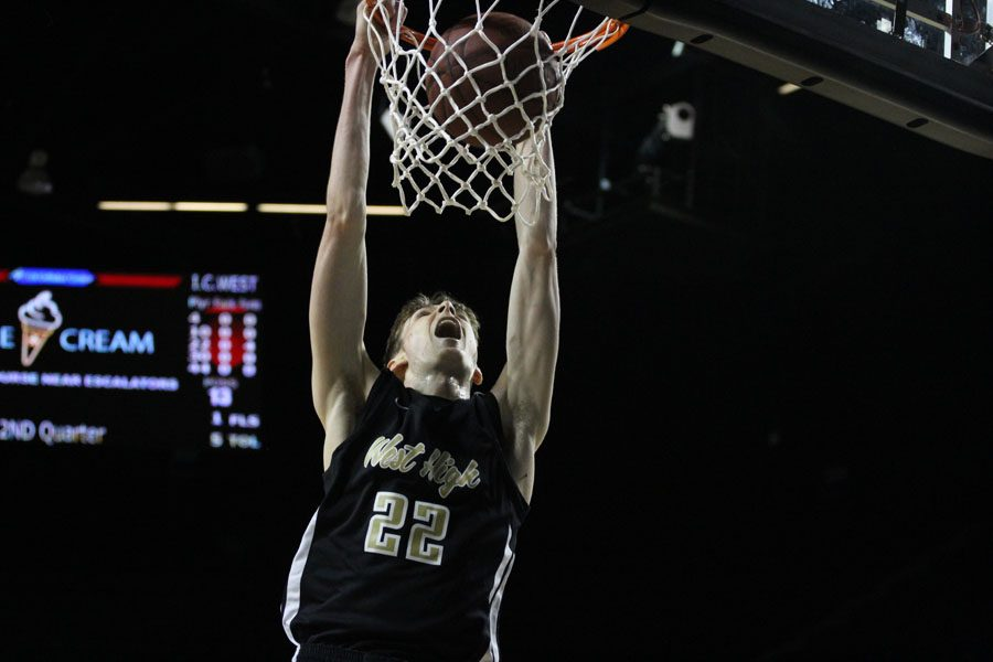 "Patrick McCaffery '19 dunks the ball during the second quarter and increases West's lead to 15 on Sat., Jan. 20. When asked about what it was like playing at the U.S. Cellular Center McCaffery said, ""There's a bit of a shock factor when you go out there for warm ups, but usually it doesn't take long to get over that and focus on the game."""