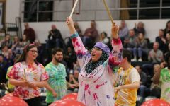 Hafiza El-Zein '19 holds her drum sticks in the air after she performed in the Best Buddies and PALS halftime show on Friday, Jan. 26.