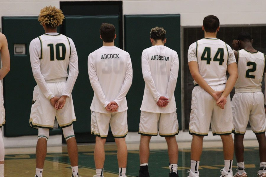The team stands together during the National Anthem on Tuesday, Jan. 30.