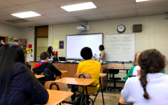 Eman Elsheikh '18 and Xena Makky '18 teach Arabic to the group on the planned MLK day on Jan. 12, 2018.