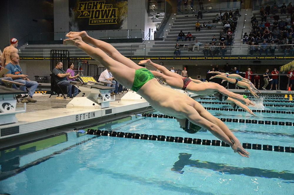 Valeri Trussov '19 takes off the starting block, poised to enter the water with minimal resistance.