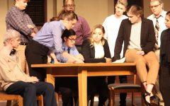 Characters huddle together to analyze sketch of the crime scene. From left to right: Cade Koch '18, Brandon Burkhardt '18, Meg Moreland '18, Sam Sunderland '19, Damarius Levi '18, Pieper Stence '18, Sean Harken '21. Paige Harken '18, Ethan Seylar '19 and Leah Brownsburger '18