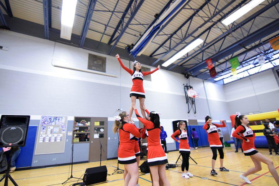 City High Sparkles cheerleading team performs during the MLK event at Grant Wood Elementary on Jan. 20, 2018.