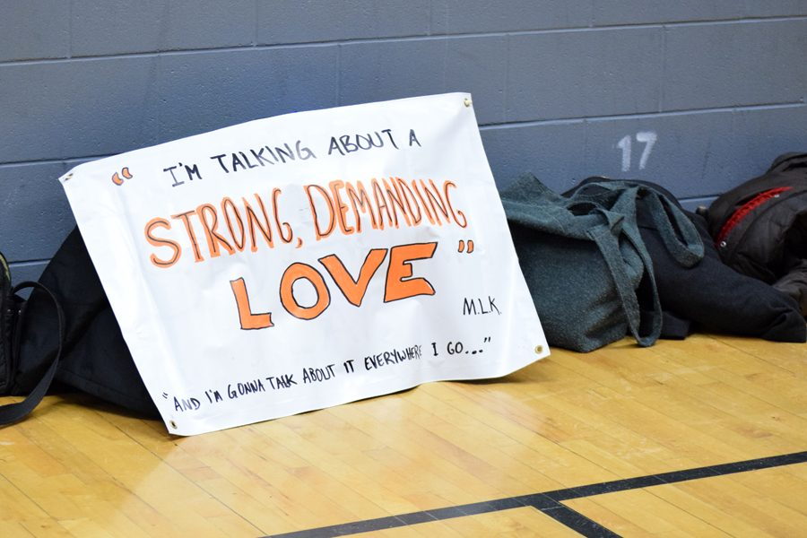 A sign from the Unity March is left on the gym floors at Grant Wood Elementary on Jan. 20, 2018.