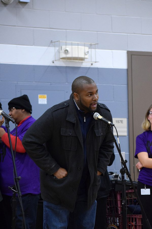 Kingsley Botchway II, an at-large city council member, speaks during the MLK event at Grant Wood Elementary on Jan. 20, 2018.