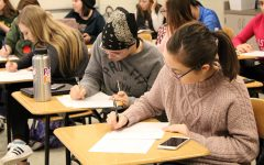Students write letters to Iowas senators in Washington D.C. after school on Thursday, Feb. 22.  The meeting was organized by student group SASS.