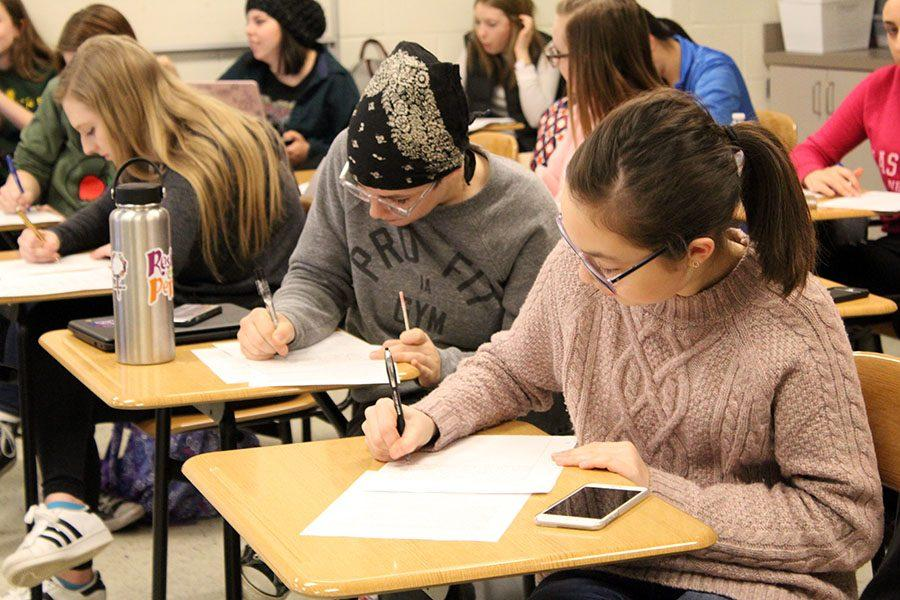 Students write letters to Iowa's senators in Washington D.C. after school on Thursday, Feb. 22.  The meeting was organized by student group SASS.