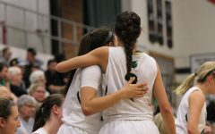 Cailyn Morgan '19 hugs Rachael Saunders '18 as they finish up the game on Friday, Feb. 9.