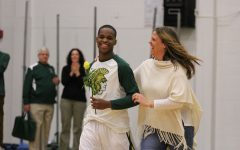 Marsean Rhodes '18 walks down during the senior ceremony with Margaret McCaffery on Tuesday, Feb. 13.