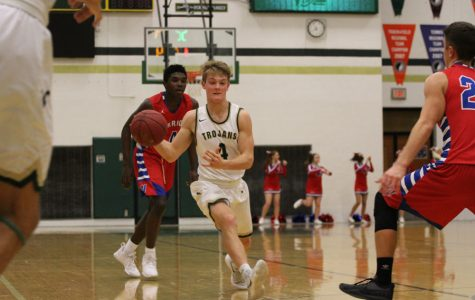 Boys basketball advances to state-qualifying game