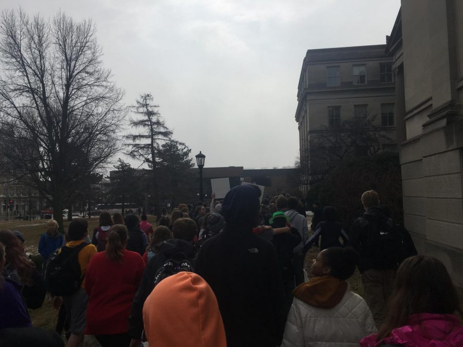 ICCSD students march through Iowa City to peacefully protest the lack of gun control on Feb. 19.