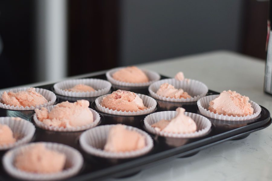 Scoop the ice cream into cupcake fillers. Aluminum cupcake fillers are preferred. Place in freezer.