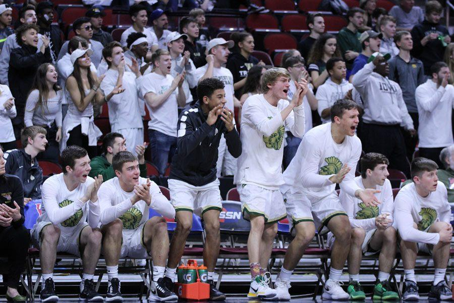 The team reacts as West gains more points to their lead on Thursday, March 8.