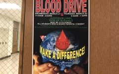 Blood drive posters hang around the school to inform students of the upcoming event.