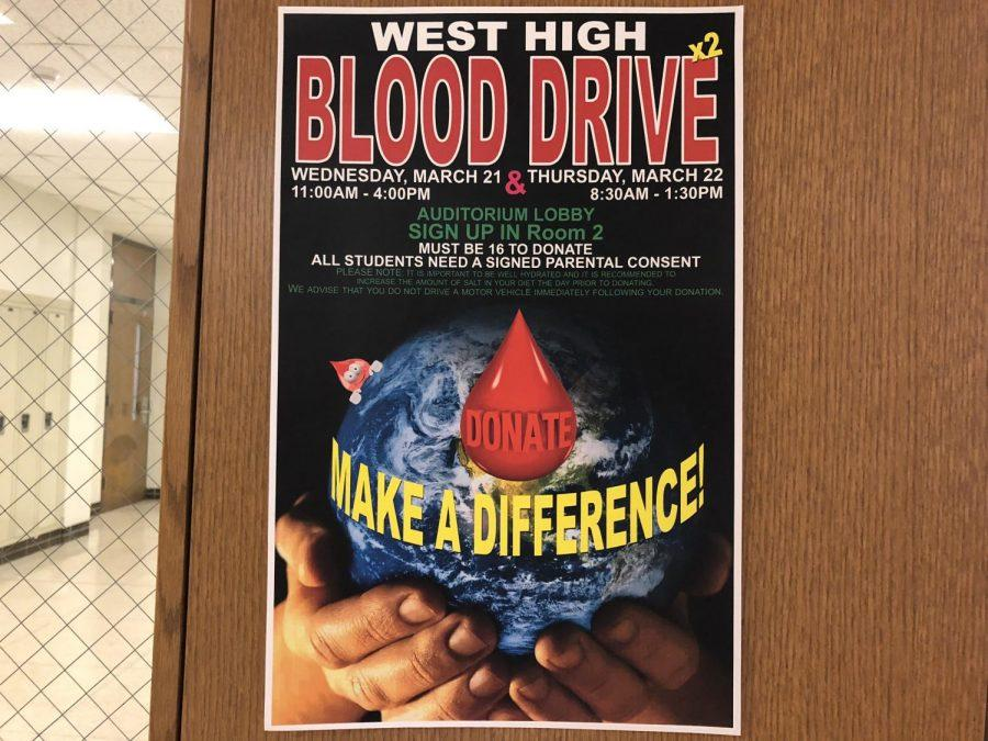 Blood+drive+posters+hang+around+the+school+to+inform+students+of+the+upcoming+event.