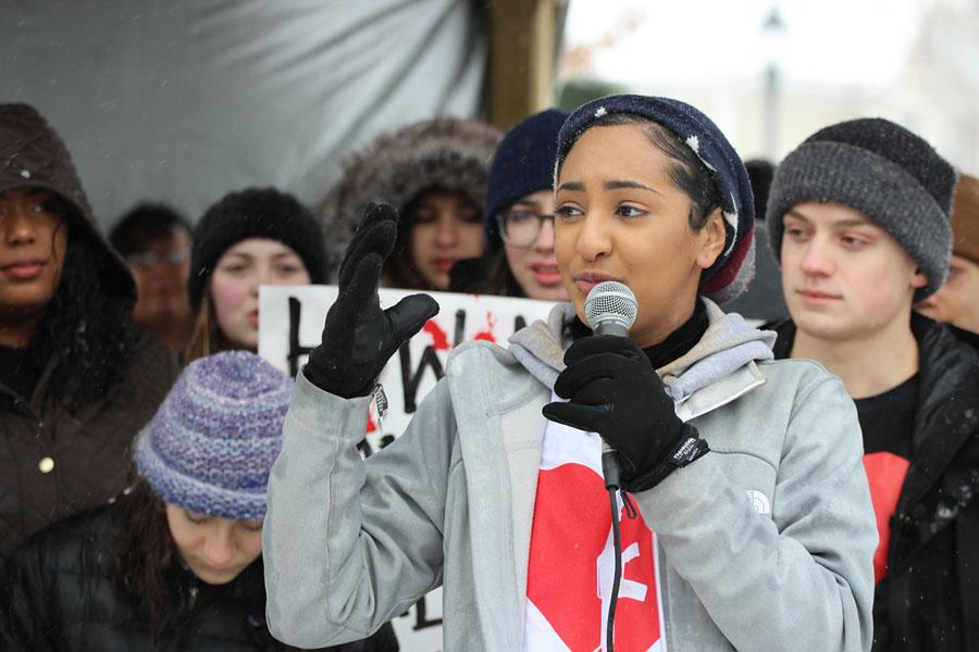 West High's Lujayn Hamad '18 gives a speech before the march at College Green Park on Saturday, March 24.