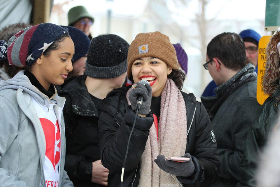 City high's Olivia Lusala '19 calls out chants for the protesters to say during the march on Saturday, March 24.