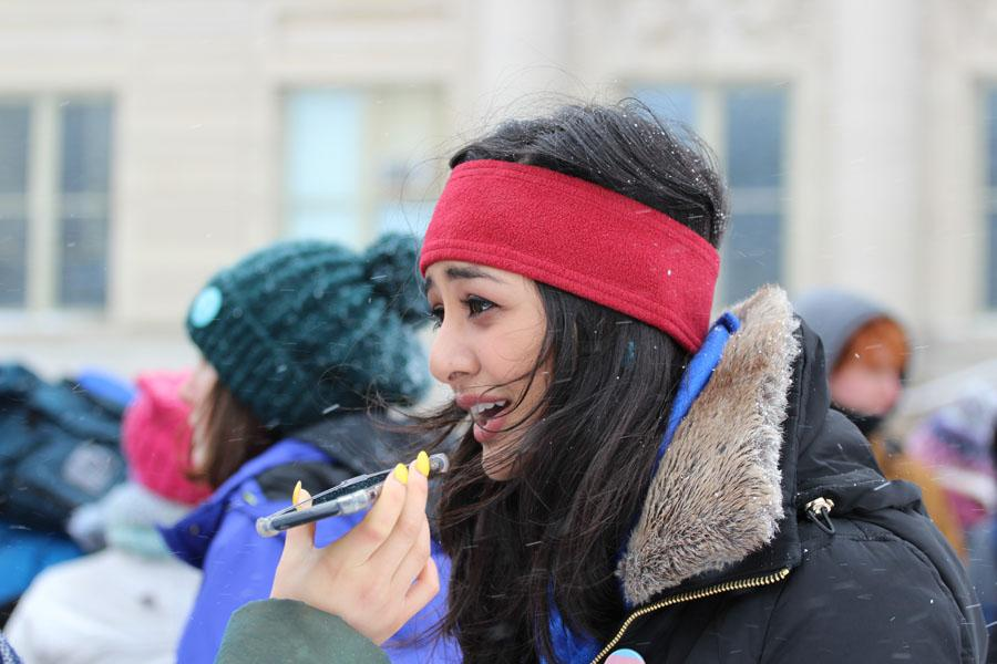 Hira Mustafa '19, a University of Iowa student, gets interviewed after the march on Saturday, March 24.