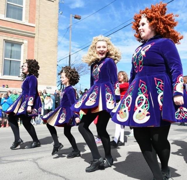 Fenna Semken '18 dances in the SaPaDaPaSo Parade in 2016 in Cedar Rapids, Iowa. During the parade, Champagne Academy of Irish Dance passes out candy and dances on street corners. In 2016, they won best costume in the parade.