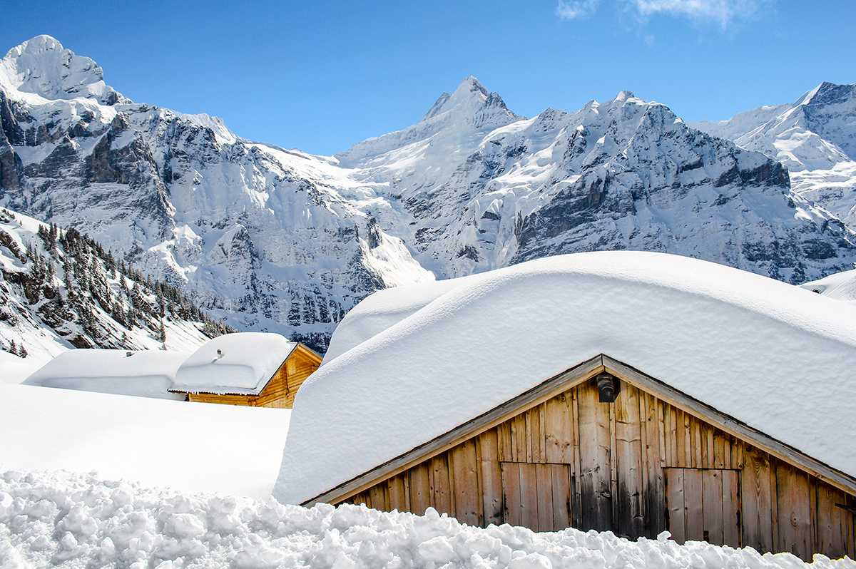 A+shot+of+a+few+cabins+high+in+the+village+of+Grindelwald%2C+Switzerland%2C+taken+in+March+2018.+