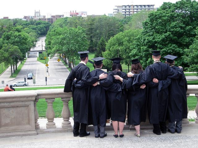 Students celebrate graduation at the Old Capitol in Iowa City.