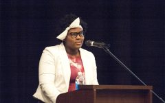 Dasia Taylor '21 introduces Dr. Terrence Roberts on April 6, 2018.