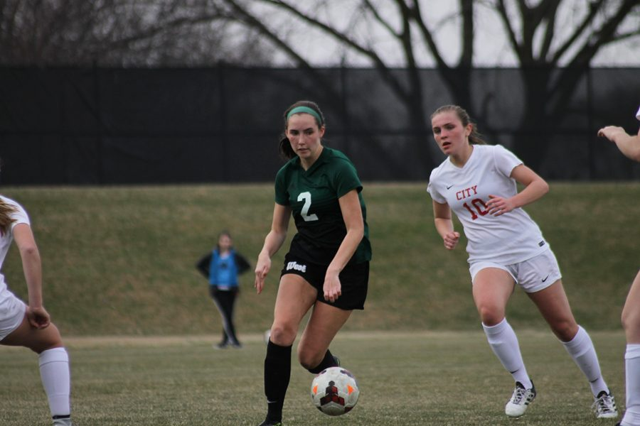 Marnie Vonderhaar '19 looks for teammate to pass the ball to on Friday, April 20.