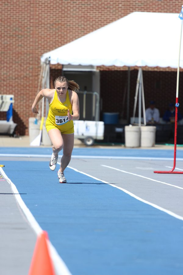 Katie+Severt+%2719+runs+down+the+track+as+she+competes+in+long+jump.+She+placed+3rd+overall+with+a+jump+of+17-11.00.