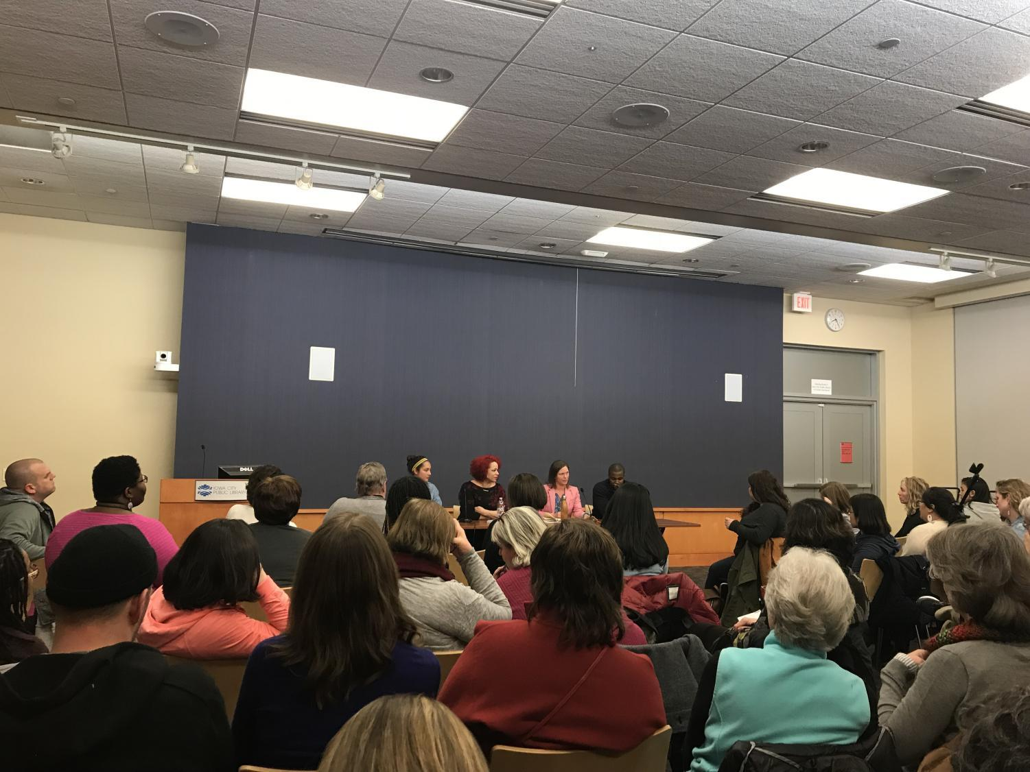 University of Iowa College of Education Assistant Professor Leslie Locke speaks on the efforts to attract diverse students to pursue a degree in education on Mon., April 2. Panelists from left to right: Maya Durham, Nikole Hannah-Jones, Leslie Locke and Kinsley Botchway.