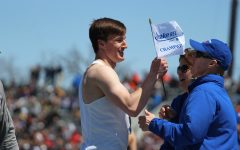 Austin West '18 holds up his Drake Relays flag after he won the 400 meter hurdle race on Saturday, April 28. He won with a time of 51.96, .02 off from breaking the meet record.