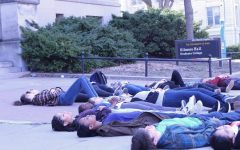 A couple dozen protesters showed up to participate in the die-in on Friday, April 20.