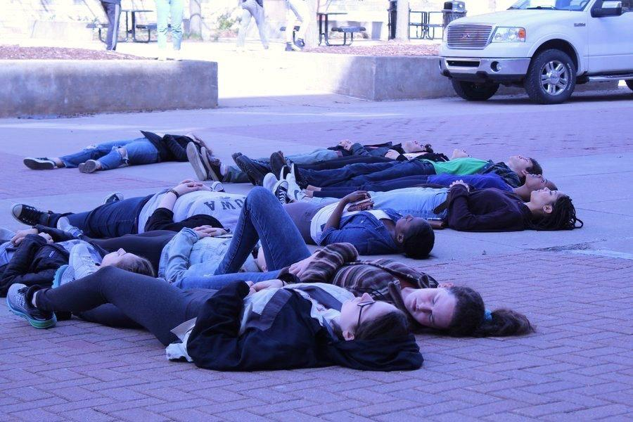 Students lie in the die-in on Friday, April 20. The demonstration was held in conjunction with the nationwide protests on the 19th anniversary of the Columbine shooting.