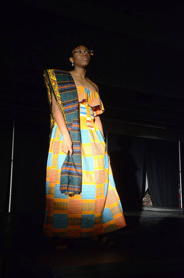 Sharon Amouzou '18 wears traditional African clothing on Saturday, March 31.