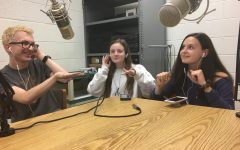Luke Reynolds '18, Jessica Doyle '19 and Natalie Dunlap '20 listen to music in the podcast lab. In this episode, the trio attempt to guess  popular songs.