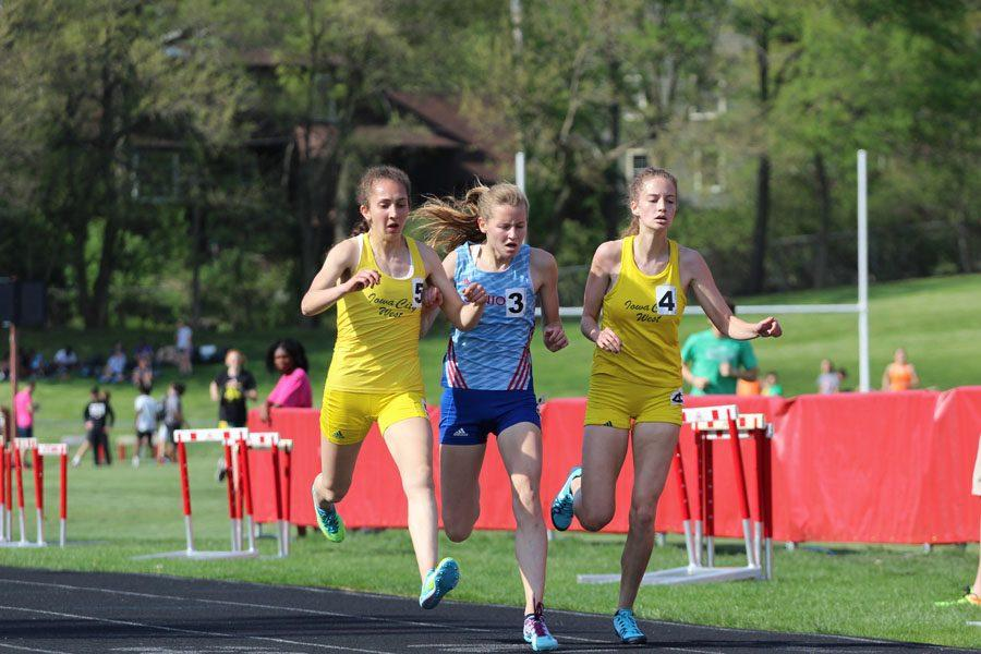 Deniz Ince '19, Claire Edmondson '20 from Dubuque Senior and Bailey Nock '18 battle for first place during the girls 3,000 meter run on Thursday, May 10. Ince placed first with a time of 10:39.49 followed by Edmondson with a time of 10:39.52 and Nock with a time of 10:39.55.