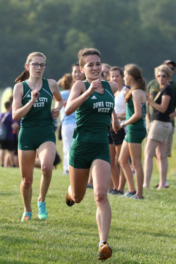 Kiara+Malloy-Salgado+%2721+sprints+towards+the+finish+line+as+teammate+Erica+Buettner+%2721+trails+behind+her+on+Thursday%2C+Aug.+23.+Malloy-Salgado+placed+8th+in+20%3A34+and+Buettner+finished+in+9th+in+a+time+of+20%3A36.