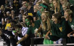 The student sections cheer for the drum line during halftime on Friday, Aug. 24.