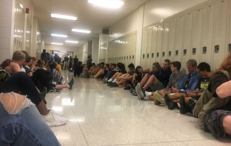 Students sit in the hallways during the tornado warning on Tuesday, Sept. 25.