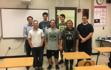 The members of Students for Open Discussion gather for a photo. From left to right, back row first: Brendon Aitken, Ronan Smith '20, Danny Rompot '19, Simon Jones '19, Sam Gienapp '19, Logan Pfannebecker '19, Hanna O'Dell '19.