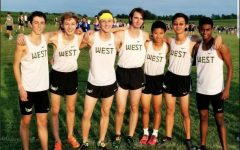 The boys varsity team stands together at the Bobcat invitational meet in Marshalltown on Thursday, Sept. 6.