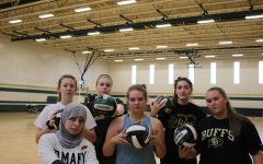 WSS staffers learn how to play volleyball