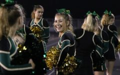 Austyn Goodale 20 stands on the sidelines as she cheers during the first home game against North Scott on Friday, Aug. 24.