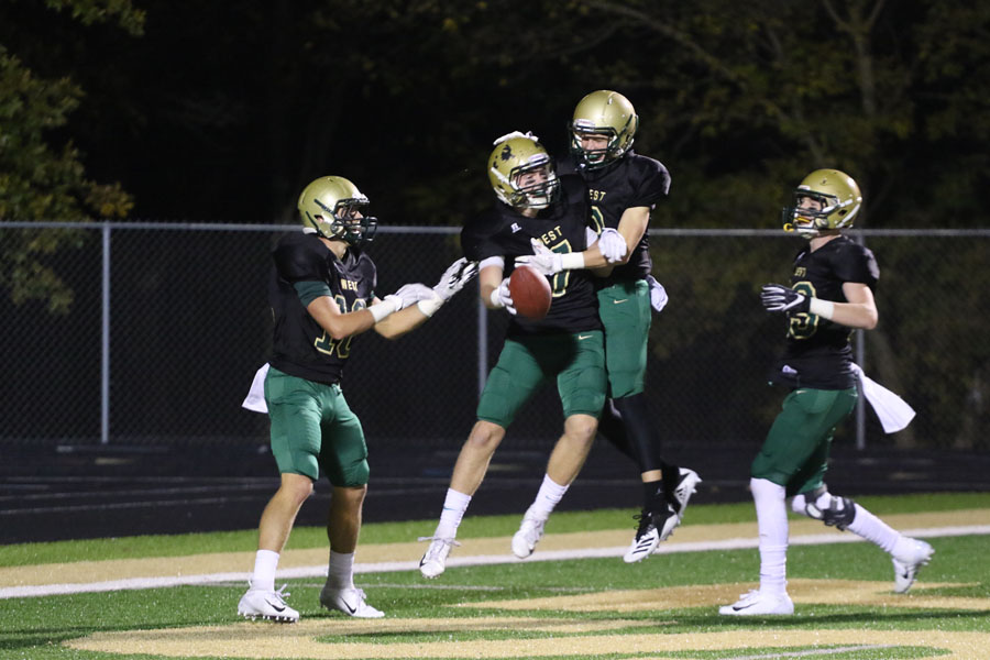 Grant+Henderson+%2720+celebrates+with+Noah+Aanestad+%2719+after+Henderson+scored+a+touchdown+during+the+second+half+on+Friday%2C+Oct.+12.