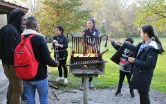 ELL students roast marshmallows over the fire at their after-school event on Wednesday, Oct. 24.
