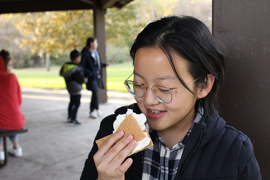 Joy Li 22 tries a smore for the first time.